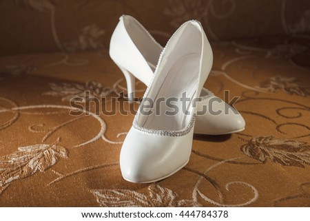 Beautiful white wedding. Shoes for the bride - stock photo