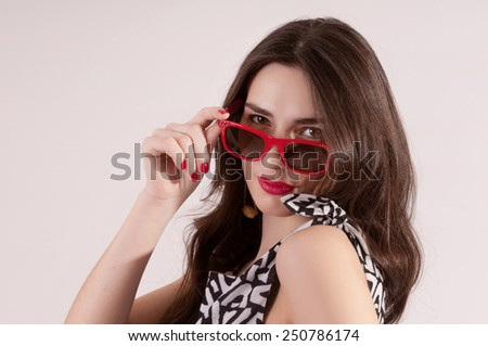 Beautiful white woman portrait classic style with red sunglasses