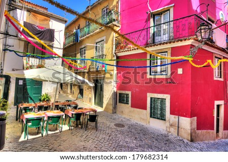 Beautiful wide angle image of the tight streets with lots of colors in Lisbon, Portugal. HDR - stock photo