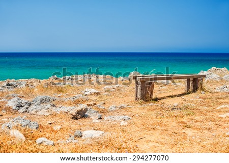 Beautiful wild beach with turquoise water and rocks. Place for relax. Malia, Crete island, Greece. Selective focus - stock photo