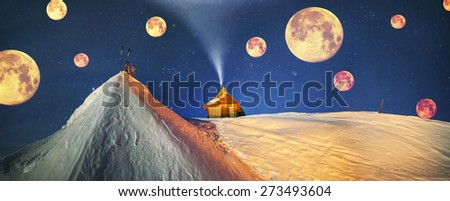 Beautiful wild Carpathian ridge - Montenegro, on the background of a powerful lantern-lit building - a refuge from snow bricks protecting tent extreme sportsmen from wind and frost - stock photo
