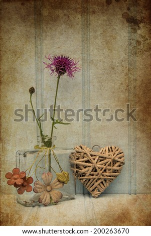 Beautiful wild flower in vase with heart still life love concept