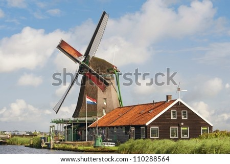 Beautiful windmill at De Zaanse Schans in the Netherlands - stock photo
