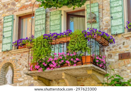 Beautiful window decorated with flowers in Italy.