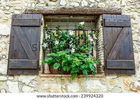 Beautiful window of the old Provence - stock photo