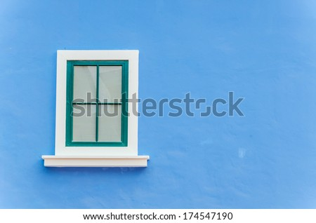 Beautiful window on color wall