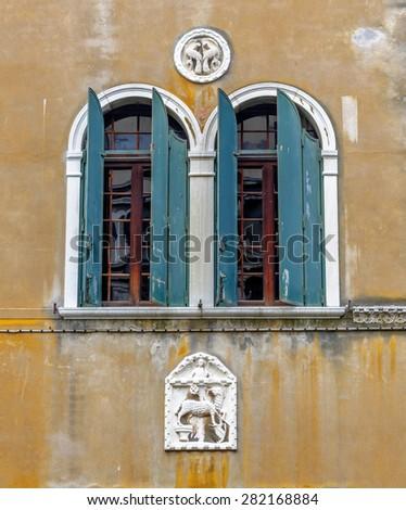 Beautiful window on the ancient wall - Venice, Italy - stock photo