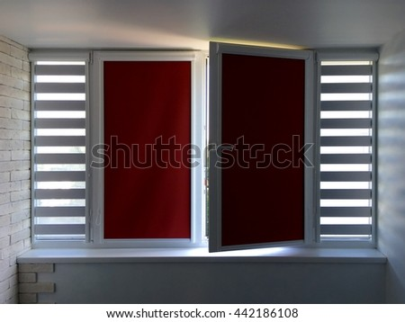 Beautiful window with roller blinds - stock photo