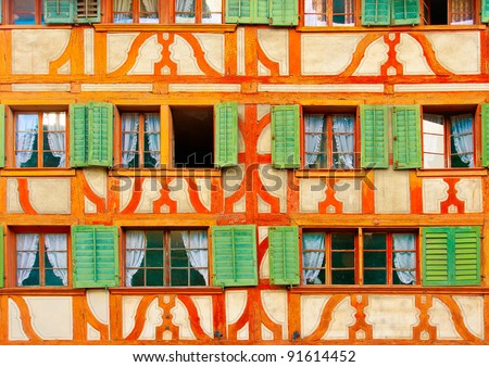 Beautiful windows on an old building in Lucerne Switzerland - stock photo