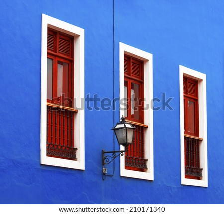 Beautiful  windows on blue building facade,  Canary Islands in  Spanish archipelago, Spain, Europe - stock photo