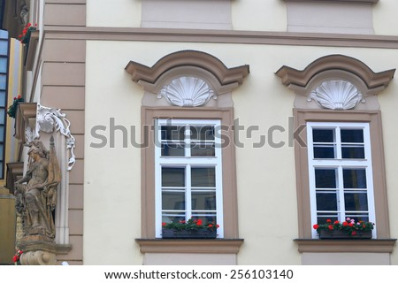 Beautiful windows on the facade of traditional building in Prague Old Town, Czech Republic - stock photo