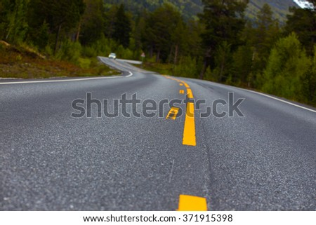 beautiful windy road at the norwegian mountains  - stock photo