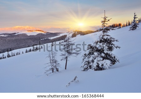 Beautiful winter evening with a sunset in the mountains - stock photo
