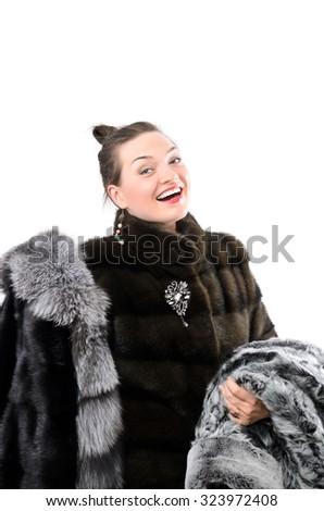 Beautiful winter girl in fur. Isolated photo. - stock photo