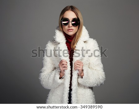 beautiful winter girl in white fur and sunglasses. winter fashion beauty young woman - stock photo