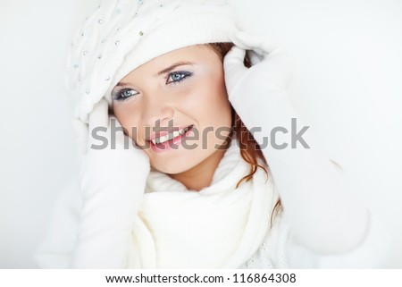 Beautiful winter girl wearing warm clothes and smiling