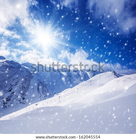 Beautiful winter landscape, high mountains covered with white snow, frosty sunny day, snowy weather, luxury ski resort - stock photo