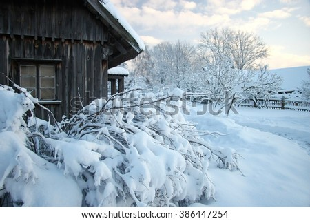 Beautiful winter landscape in the  forest village. Wood house in snow fairy forest, Latvia - stock photo