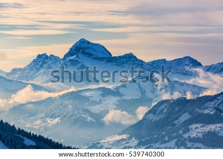 Beautiful winter landscape in the Mont Blanc Massif with the view to the Chaine des Aravis above the clouds and villages.