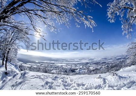 Beautiful winter landscape on the hillside - stock photo