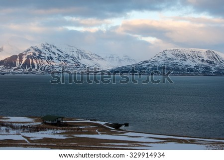 Beautiful winter landscape with a little cottage at a shore. Iceland. - stock photo