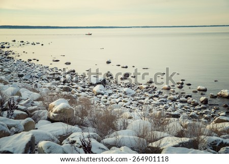 beautiful winter landscape with a sea view - stock photo
