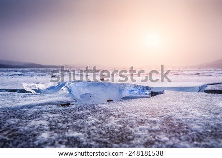 Beautiful winter landscape with ice and snow on the lake - stock photo