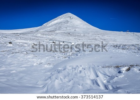 Beautiful winter landscape with mountains covered by sparkly snow