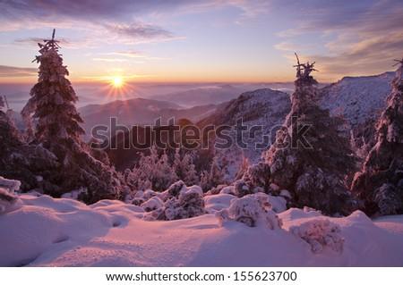beautiful winter mountain sunset in Romania - stock photo