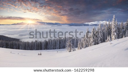 Beautiful winter mountains in the morning mist - stock photo