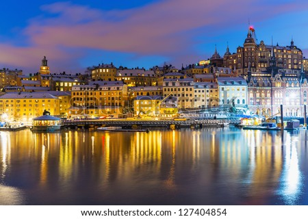 Beautiful winter night snowy scenery of Slussen district of the Old Town (Gamla Stan) in Stockholm, Sweden - stock photo