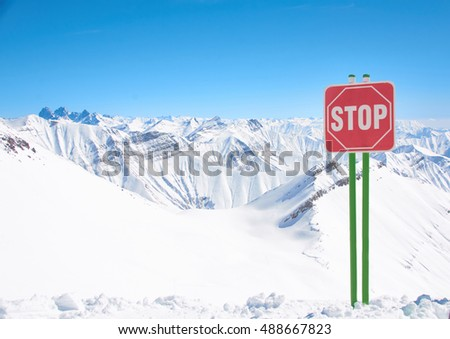 Beautiful winter peaks in mountains on ski resort in season of snowboard. High blue bright sky with white clouds in sunny day. Background for extreme sports.