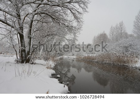 Beautiful winter scene on Yauza river after heavy snowfall, Babushkinkiy district, Moscow.