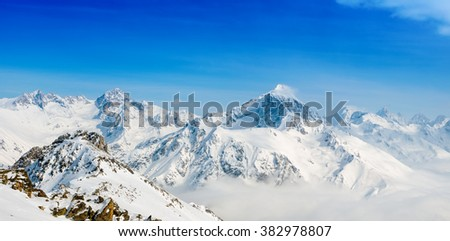 beautiful winter snow covered peaks of Dombaj mountain, panorama