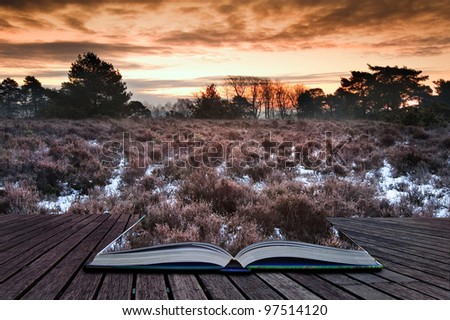 Beautiful Winter sunrise landscape over vibrant snow covered countryside landscape coming out of pages in magic book
