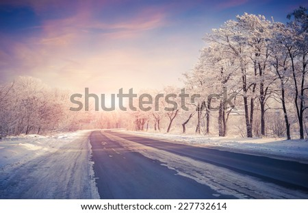 Beautiful winter sunrise on the highway - stock photo