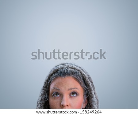 Beautiful Winter Woman with frost makeup on blue background - stock photo