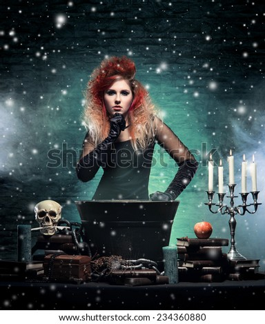 Beautiful witch making witchcraft over winter background - stock photo