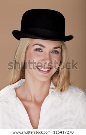 Beautiful woman. A beautiful blond woman wearing a bowler hat. - stock photo