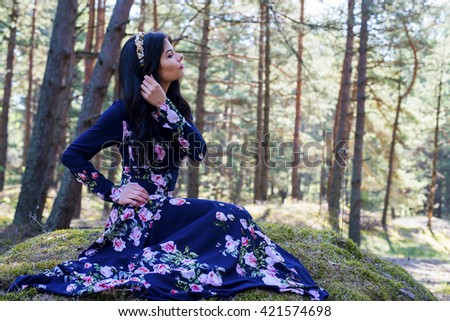Beautiful woman, a fairy princess in a summer forest - stock photo