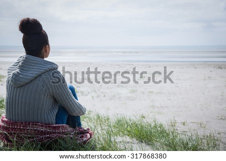 Beautiful woman admiring the view at the beach - stock photo