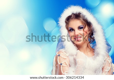 beautiful woman against colorful  background, Christmas topic - stock photo