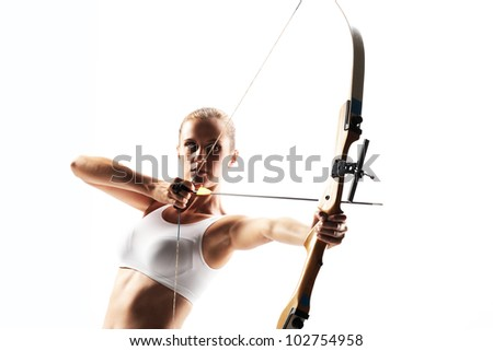 Beautiful woman aiming with bow and arrow - stock photo