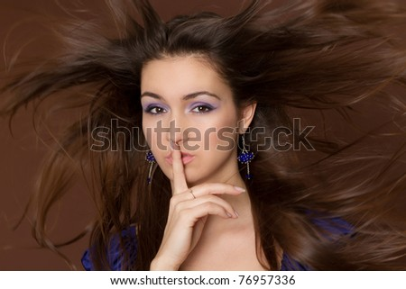 Beautiful Woman. Amazing Brunette with flying hair. - stock photo