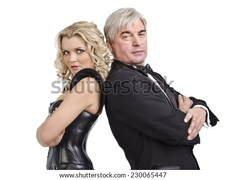 Beautiful woman and a brutal man in black clothes standing on white isolated background