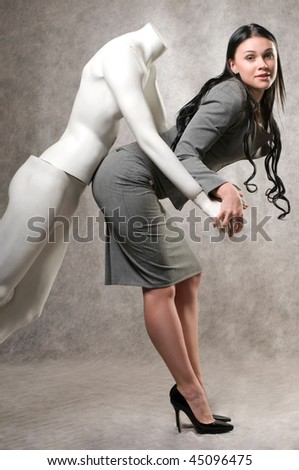 Beautiful woman and a male mannequin imitation sex - stock photo