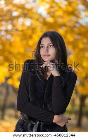 Beautiful  woman and autumn tress - stock photo