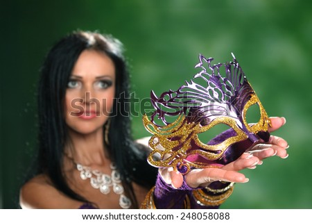 beautiful woman and carnival mask . beautiful, active dancer in a lush, gorgeous dance costumes. dance movements, artistic emotions. the Arab Dance - stock photo