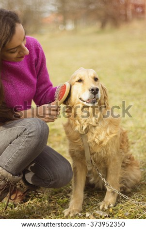 beautiful woman and golden retriever