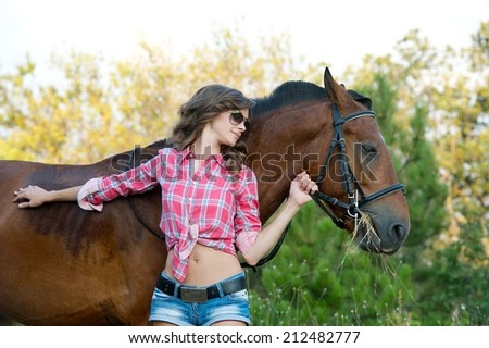beautiful woman and her handsome horse on autumn field
